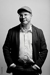 Andy Weir, author of Artemis. Click to find 5 more awesome sci fi books with strong female leads.
