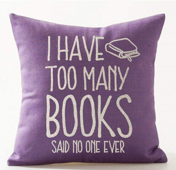 The best gifts for book lovers this Christmas season, including a reading themed pillow!