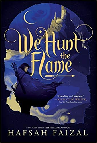 "Alt text: Book with a black cover and an illustration of a mountain with a castle, and a girl in a blue cloak with quiver of arrows on her back. The title ""We Hunt The Flame"" is on the top half of the book in fancy gold letters."